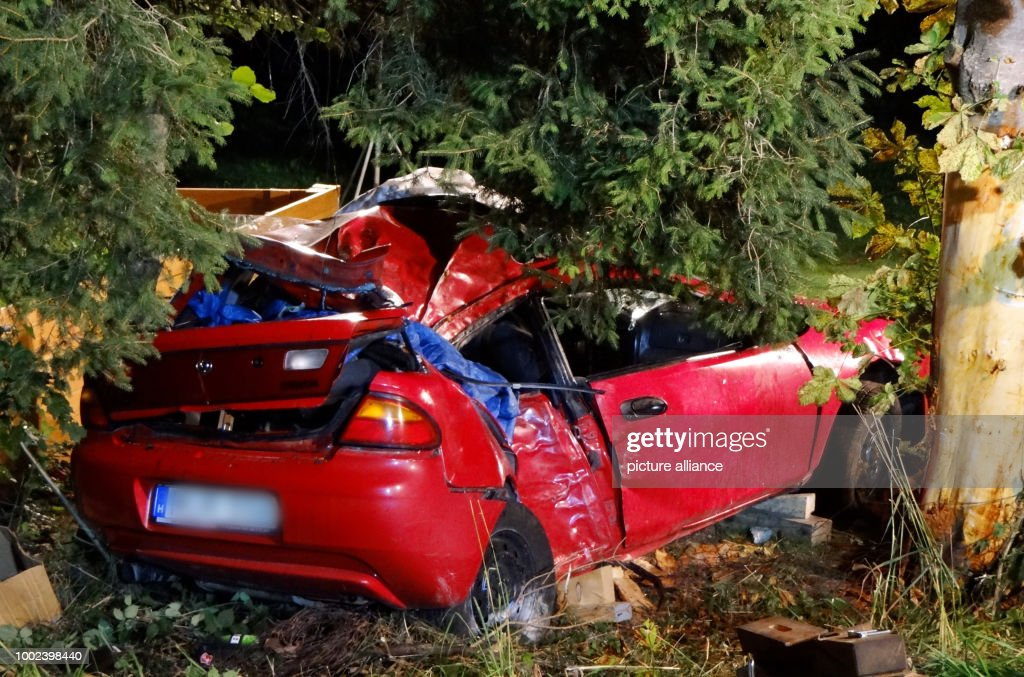 A damaged vehicle at an accident site near Frankenhofen, Germany