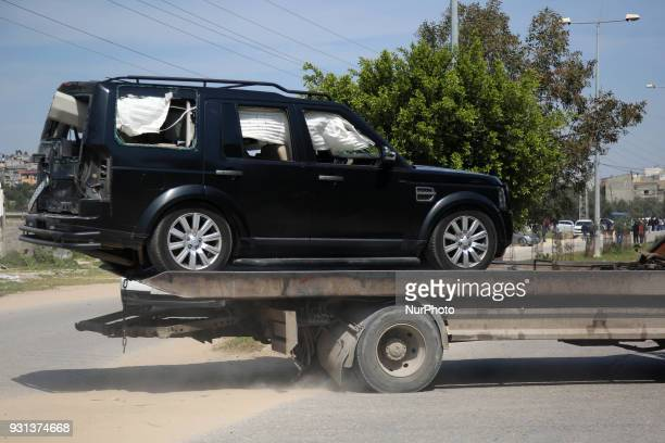 A damaged vehicle is removed from the site of an explosion that occurred as the convoy of Palestinian Prime Minister Rami Hamdallah entered Gaza...