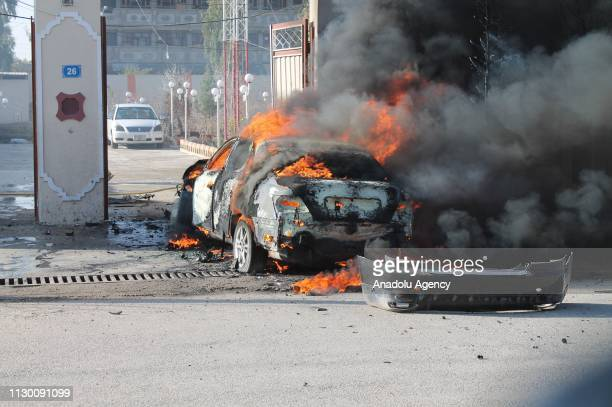 Damaged vehicle is seen after a bomb placed under a car exploded in Helmand Afghanistan on March 12 2017 Nisar Ahmad Ahmadi a local journalist in...