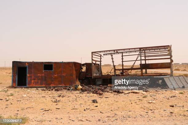 """Damaged vehicle is seen after clashes as Libyan Army make preparations at Ebu Gireyn and Viske regions within their operation named """"Path of Victory""""..."""