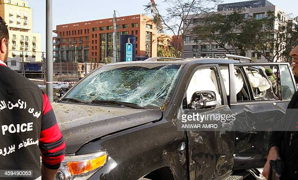 A damaged vehicle is seen at the site of a car bomb explosion in central Beirut on December 27 2013 The explosion that hit central Beirut killed five...
