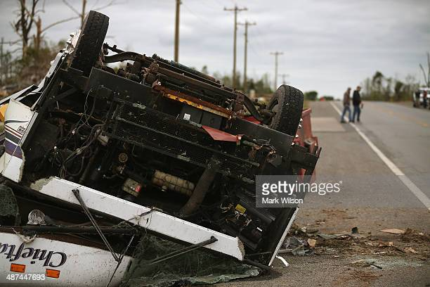 A damaged vehicle lays on the side of the road after it was blown over by a tornado April 30 2014 in Mayflower Arkansas Deadly tornadoes ripped...