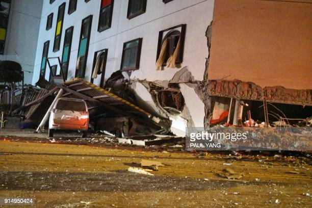 A damaged vehicle stands in rubble outside the Marshal Hotel in Hualien eastern Taiwan early February 7 after a strong earthquake struck the island A...