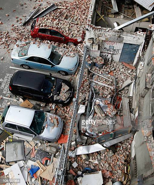 Damaged vehicles and debris are seen in the central business district on March 2, 2011 in Christchurch, New Zealand. The death toll from the...