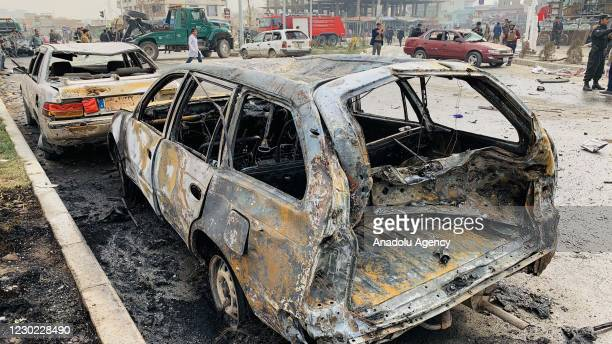 Damaged vehicles are seen after a bomb-laden car exploded in Afghanistan's capital Kabul, killing at least nine and injuring 20, including Afghan...