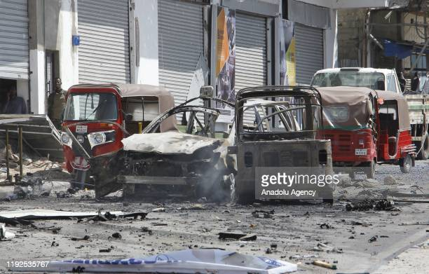 Damaged vehicles are seen at the site after a car bombing near Somali parliament building in the countrys capital Mogadishu on January 8, 2020. At...