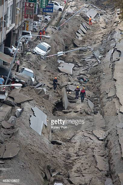 Damaged vehicles lie on the damaged road after gas explosions in southern Kaohsiung on August 1, 2014 in Kaohsiung, Taiwan. A series of powerful gas...