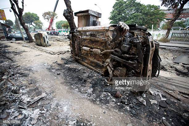 Damaged vehicles lie on the road after gas explosions in southern Kaohsiung on August 1, 2014 in Kaohsiung, Taiwan. A series of powerful gas blasts...