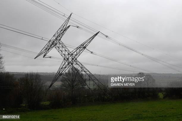 A damaged very high voltage electrical pylon lies in a field in Montabot western France on December 11 after an alleged act of sabotage The...