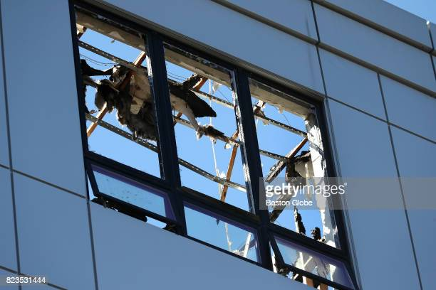 A damaged window at the Treadmark building in the Dorchester neighborhood of Boston July 26 2017 Last month a sixalarm fire tore through the building...