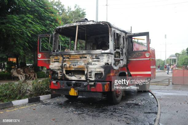 Damaged/burnt Vehicles of Fire brigade during Clash between Dera Sacha Sauda followers and Security personals and media after the Dera chief Gurmeet...