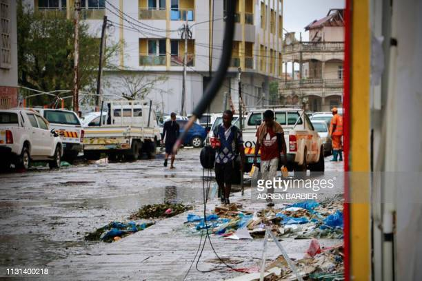 Damages are seen in a street of Beira Mozambique on March 17 in the aftermath of the passage of the cyclone Idai A cyclone that ripped across...