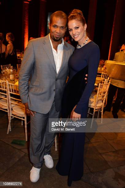 Damani Baker and Cameron Russell wearing Stella Mccartney attend The Green Carpet Fashion Awards Italia 2018 after party at Gallerie d'Italia on...