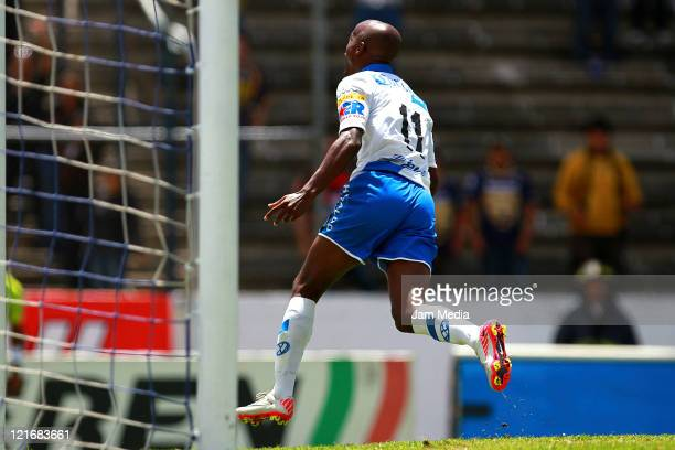 Damarcus Bealey of Puebla celebrate a scored goal during a match between Puebla and Pumas as part of the Apertura 2011 at Cuauhtemoc Stadium on...