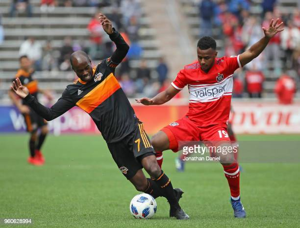 DaMarcus Beasley of Houston Dynamo and Mo Adams of Chicago Fire battle for the ball at Toyota Park on May 20 2018 in Bridgeview Illinois The Dynamo...