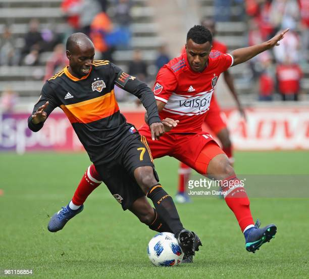DaMarcus Beasley of Houston Dynamo and Mo Adams of Chicago Fire battle for the ball at Toyota Park on May 20, 2018 in Bridgeview, Illinois. The...