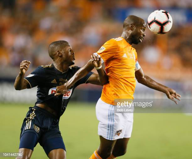 DaMarcus Beasley of Houston Dynamo heads the ball away from Fafa Picault of Philadelphia Union in the first half during the 2018 Lamar Hunt U.S. Open...
