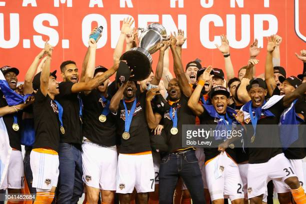 DaMarcus Beasley of Houston Dynamo lifts up the championship trophy after defeating the Philadelphia Union 30 during the 2018 Lamar Hunt US Open Cup...