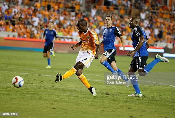 DaMarcus Beasley of Houston Dynamo scores a second half goal past two San Jose Earthquakes defenders during their game at BBVA Compass Stadium on...