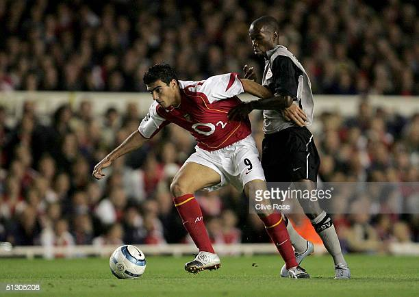 Damarcus Beasley of PSV Eindhoven tries to tackle Jose Antonio Reyes of Arsenal during the UEFA Champions League, Group E match between Arsenal and...