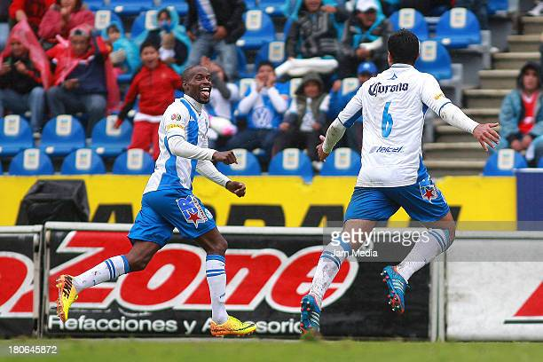 Damarcus Beasley of Puebla celebrates score a goal against Toluca during a match as part of Apertura 2013 Liga MX at Cuauhtemoc Stadium on September...