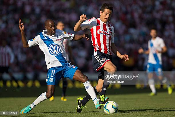 Damarcus Beasley of Puebla fights for the ball with Erick Torres of Chivas during a match between Puebla and Chivas as part of the Clausura 2013 at...