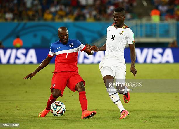DaMarcus Beasley of the United States is challenged by Daniel Opare of Ghana during the 2014 FIFA World Cup Brazil Group G match between Ghana and...