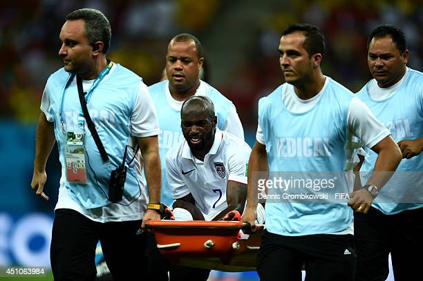 DaMarcus Beasley of the United States is taken off the pitch by a stretcher during the 2014 FIFA World Cup Brazil Group G match between USA and...