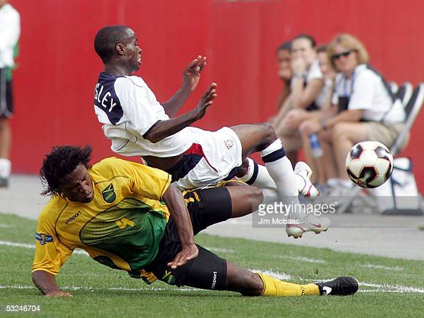 DaMarcus Beasley of the United States is taken out of the play by Jermaine Taylor of Jamaica during the CONCACAF quarterfinal match on July 16 2005...