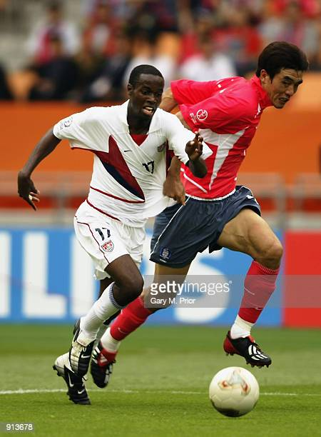 DaMarcus Beasley of the USA uses his pace to go past Jin Cheul Choi of South Korea during the FIFA World Cup Finals 2002 Group D match played at the...