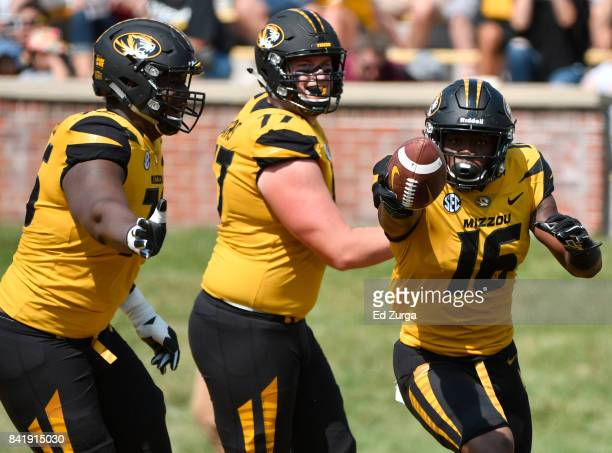 Damarea Crockett of the Missouri Tigers celebrates his touchdown with Tyler Howell and Paul Adams in the first quarter at Memorial Stadium on...