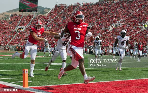 Damari Simpkins of the Utah Utes hopes into the end zone for a touchdown against the Northern Illinois Huskies at Rice-Eccles 8 Stadium on September...