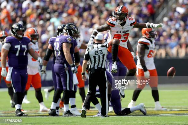 Damarious Randall of the Cleveland Browns celebrates after sacking quarterback Lamar Jackson of the Baltimore Ravens in the first half at MT Bank...