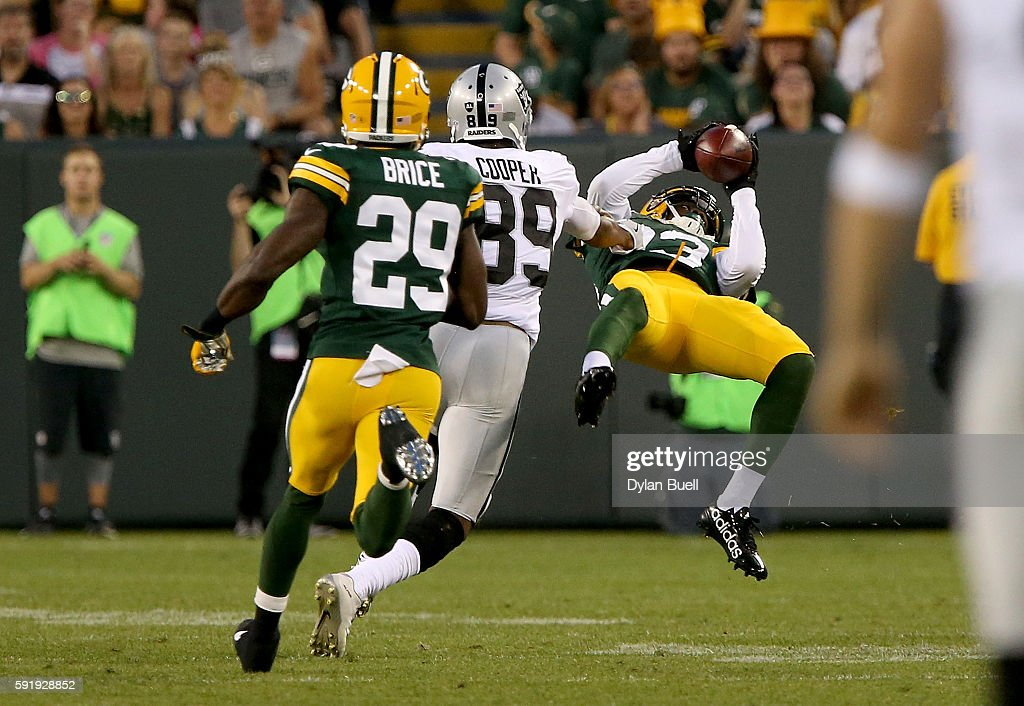 Damarious Randall #23 of the Green Bay Packers makes an interception in the second quarter of a preseason game against the Oakland Raiders at Lambeau Field on August 18, 2016 in Green Bay, Wisconsin.