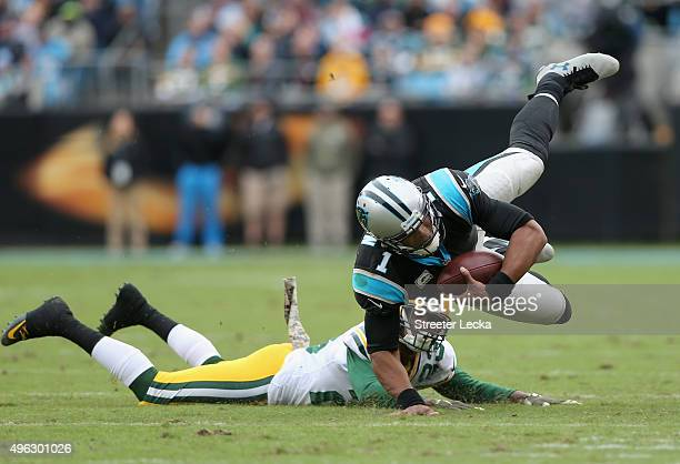 Damarious Randall of the Green Bay Packers tackles Cam Newton of the Carolina Panthers during their game at Bank of America Stadium on November 8...
