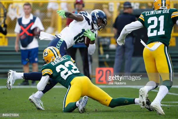 Damarious Randall of the Green Bay Packers tackles Paul Richardson of the Seattle Seahawks during the fourth quarter at Lambeau Field on September 10...