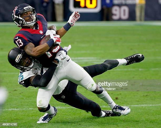 Damaris Johnson of the Houston Texans is tackled by Demetrius McCray of the Jacksonville Jaguars in the third quarter in a NFL game on December 28...