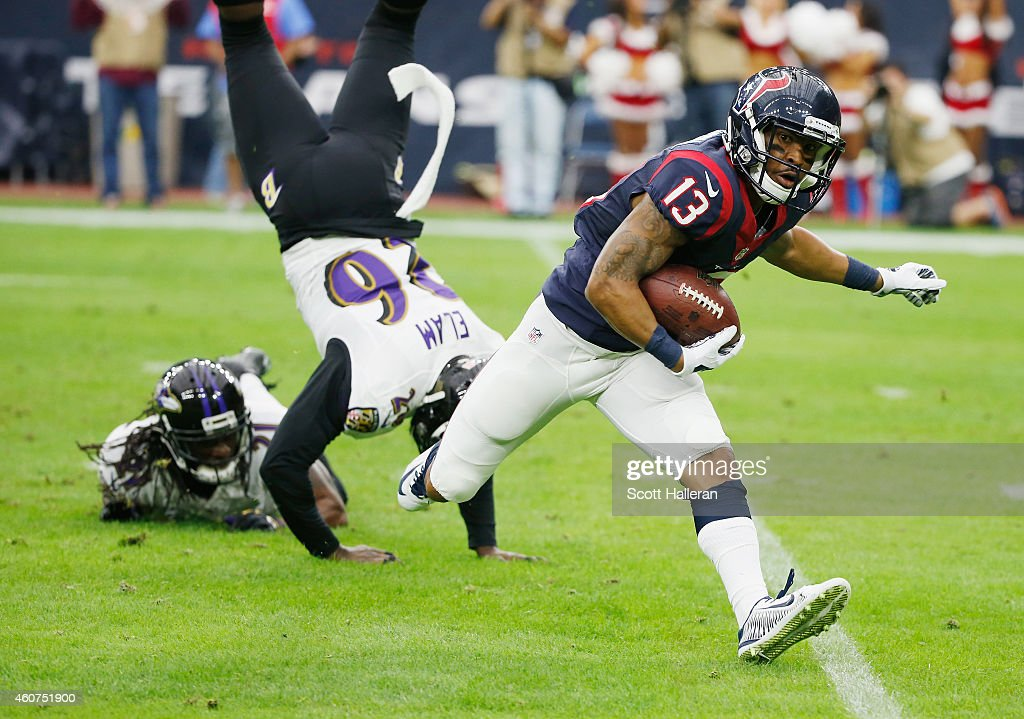 Damaris Johnson #13 of the Houston Texans runs with the ball in front of Matt Elam #26 of the Baltimore Ravens during the game at NRG Stadium on December 21, 2014 in Houston, Texas.