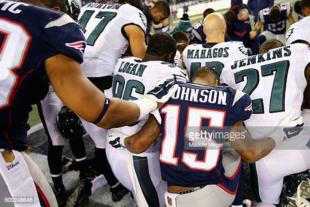 Damaris Johnson of the New England Patriots prays with Bennie Logan of the Philadelphia Eagles and Malcolm Jenkins after the Eagles defeat the...
