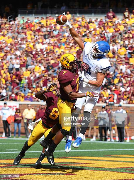 Damarius Travis of the Minnesota Golden Gophers breaks up a pass intended for Robert Tonyan Jr #18 of the Indiana State Sycamores in the second...