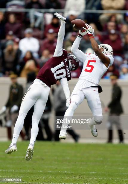 DaMarkus Lodge of the Mississippi Rebels makes a catch over Myles Jones of the Texas A&M Aggies in the second quarter at Kyle Field on November 10,...