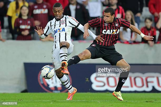 Damasceno of AtleticoPR competes for the ball with Malcom of Corinthians during the match between AtleticoPR and Corinthians for the Brazilian Series...