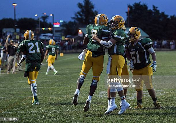 Damascus Hornets Elijah Atkins and Damascus Hornets quarterback Wade Rippeon celebrate after a Hornets' touchdown during the game between the Watkins...