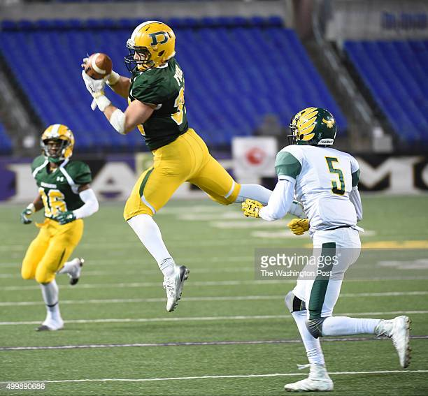 Damascus RB Jake Funk hauls in a pass during the Maryland 3A football state championship game action against Dundalk on December 3 2015 in Baltimore...
