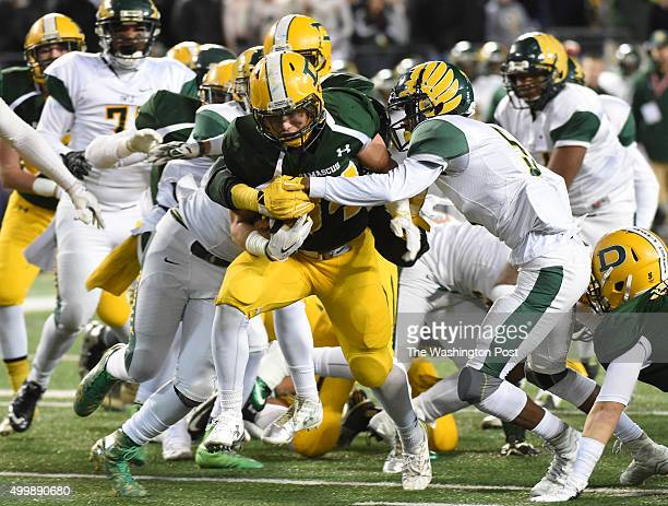 Damascus RB Jake Funk rumbles for extra yardage with Dundalk defenders on his back during the Maryland 3A football state championship game on...