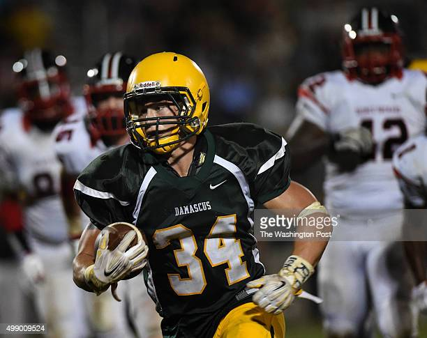 Damascus senior running back Jake Funk heads towns the end zone on his way to scoring during the second half of the season opener between Damascus...