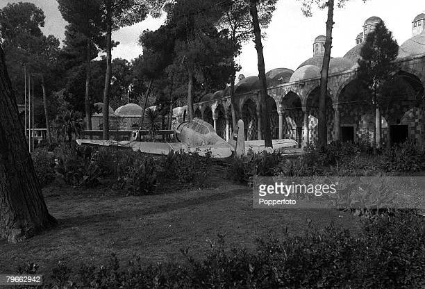 Damascus Syria 23rd December 1971 A view of the Al Takyeh Al Suleimanieh Mosque showing an Old French fighter plane parked in the grounds