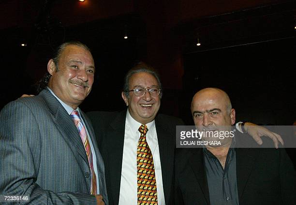 Egyptian film and TV star Nur alSharif poses with fellow actor Faruq alFishawi and Syrian actor Salluom Haddad at the opening ceremony of the 13th...