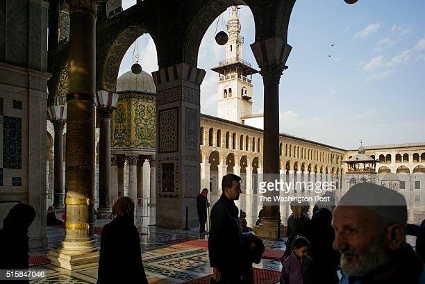 Visitors at entrance of the Umayyad Mosque in Damascus on March 8 2016