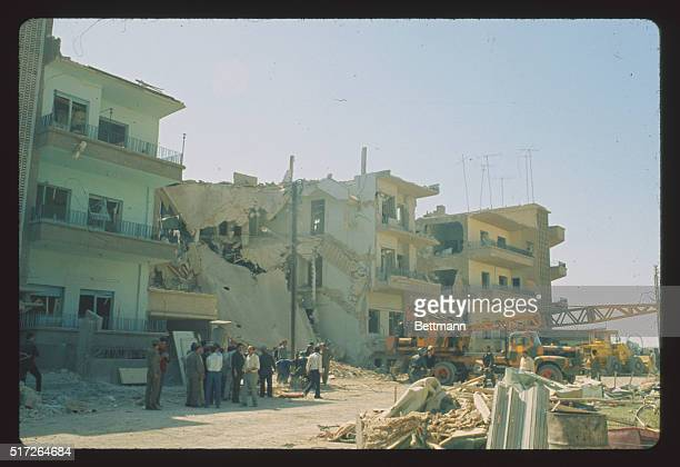 People viewing the remains of wrecked homes and buildings which were damaged during an Israeli air raid